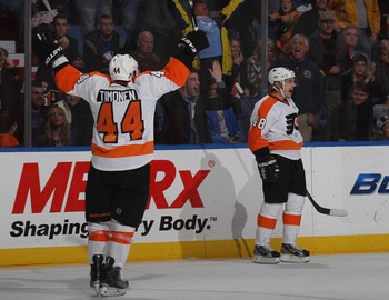UNIONDALE, NY - NOVEMBER 23: Danny Briere #48 of the Philadelphia Flyers (R) scores at 2:34 of overtime to defeat the New York Islanders 4-3 and is joined by Kimmo Timonen #44 (L) at the Nassau Veterans Memorial Coliseum on November 23, 2011 in Uniondale,