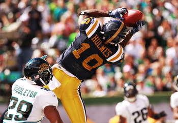 EAST RUTHERFORD, NJ - SEPTEMBER 18: Santonio Holmes #10 of the New York Jets catches a first quarter touchdown against the Jacksonville Jaguars at MetLife Stadium Stadium on September 18, 2011 in East Rutherford, New Jersey.  (Photo by Nick Laham/Getty Im