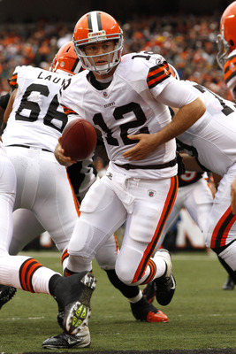 CINCINNATI, OH - NOVEMBER 27:  Colt McCoy #12 of the Cleveland Browns looks to hand off the ball during the game against the Cincinnati Bengals at Paul Brown Stadium on November 27, 2011 in Cincinnati, Ohio.  (Photo by Tyler Barrick /Getty Images)