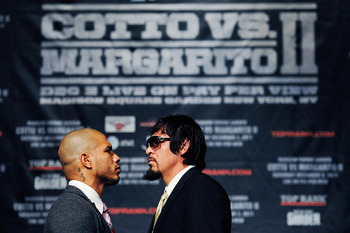 NEW YORK, NY - SEPTEMBER 20:  Professional boxers Miguel Cotto (L) and Antonio Margarito pose for the media after a press conference at the Edison Ballroom on September 20, 2011 in New York City.  (Photo by Patrick McDermott/Getty Images)