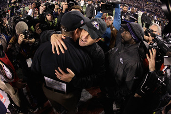 The Harbaugh brothers embrace following the game