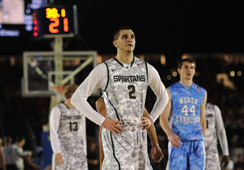 CORONADO, CA - NOVEMBER 11:  Alex Gauna #2 of the Michigan State Spartans reacts in front of Tyler Zeller #44 of the North Carolina Tar Heels during the Quicken Loans Carrier Classic on board the USS Carl Vinson on November 11, 2011 in Coronado, Californi
