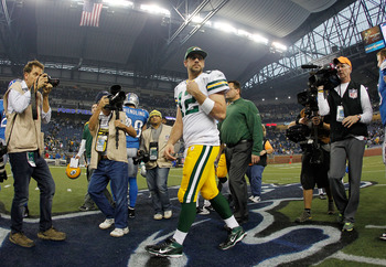 DETROIT, MI - NOVEMBER 24:  Aaron Rodgers #12 of the Green Bay Packers leaves the field after a 27-15 win over the Detroit Lions at Ford Field on November 24, 2011 in Detroit, Michigan.  (Photo by Gregory Shamus/Getty Images)