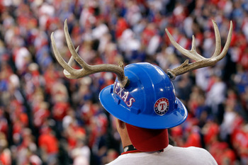 ARLINGTON, TX - OCTOBER 23: A Texas Rangers fans watches the action during Game Four of the MLB World Series against the St. Louis Cardinals at Rangers Ballpark in Arlington on October 23, 2011 in Arlington, Texas.  (Photo by Rob Carr/Getty Images)