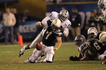 SAN DIEGO, CA - NOVEMBER 10:  Quarterback Philip Rivers #17 of the San Diego Chargers loses the football as he is sacked on the final play of the game by defensive lineman Tommy Kelly #93 of the Oakland Raiders at Qualcomm Stadium on November 10, 2011 in