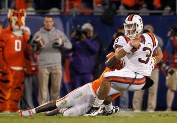 Hokies QB Logan Thomas is dragged down in a loss to Clemson in the ACC Championship Game, 38-10.