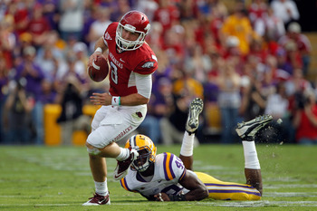 Arkansas QB Tyler Wilson evades an LSU defender. The Hogs would lose, 41-14.