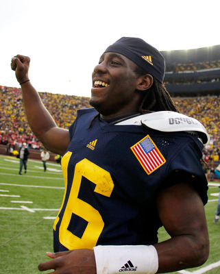 Michigan QB Denard Robinson celebrates after defeating Ohio State 40-34.