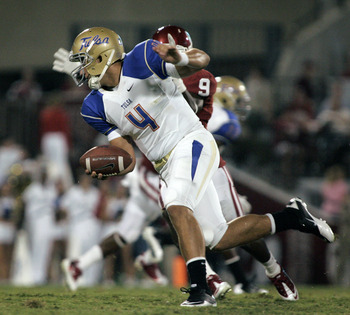 Tulsa QB G.J.Kinne scrambles for his life against Oklahoma - The Sooners won 47-14 in the opener