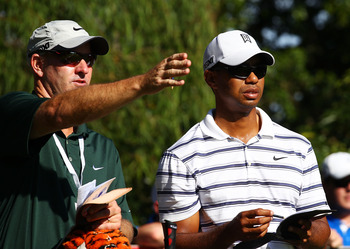 Lacava and Woods study the course in Australia