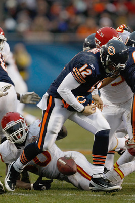 CHICAGO, IL - DECEMBER 4:  Caleb Hanie #12 of the Chicago Bears fumbles the football during the game against the Kansas City Chiefs at Soldier Field on December 4, 2011 in Chicago, Illinois. The Chiefs defeated the Bears 10-3. (Photo by Scott Boehm/Getty