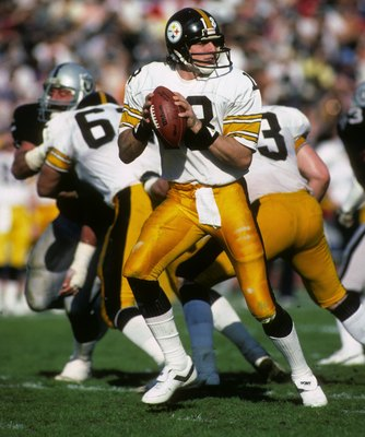 Cliff Stoudt drops back to pass during a 1983 playoff game.