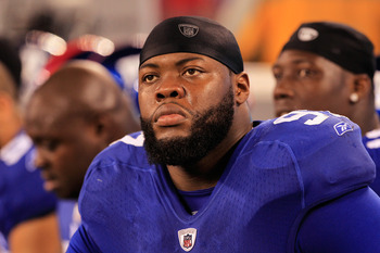 EAST RUTHERFORD, NJ - DECEMBER 04:  Linval Joseph #97 of the New York Giants looks on against the Green Bay Packers at MetLife Stadium on December 4, 2011 in East Rutherford, New Jersey.  (Photo by Chris Trotman/Getty Images)