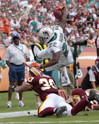 MIAMI, FL - NOVEMBER 13: Reggie Bush #22 of the Miami Dolphins is knocked out of bounds short of the end zone by LaRon Landry #30 of the Washington Redskins on November 13, 2011 at Sun Life Stadium in Miami, Florida. The Dolphins defeated the Redskins 20-