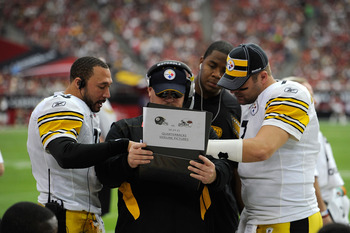 GLENDALE, AZ - OCTOBER 23:  Quarterbacks Charlie Batch #16, Byron Leftwich, and Ben Roethlisberger #7 of the Pittsburgh Steelers talk with offensive co-ordinator Bruce Arians (C) during their game against the Arizona Cardinals at University of Phoenix Sta