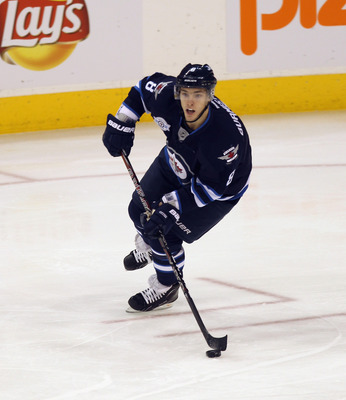 WINNIPEG, MB - NOVEMBER 29:  Alex Burmistrov #8 of the Winnipeg Jets skates against the Ottawa Senators at the MTS Centre on November 29, 2011 in Winnipeg, Canada. The Senators defeated the Jets 6-4.  (Photo by Bruce Bennett/Getty Images)
