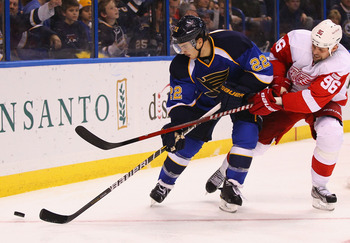 ST. LOUIS, MO - NOVEMBER 15: Kevin Shattenkirk #22 of the St. Louis Blues controls the puck against Tomas Holmstrom #96 of the Detroit Red Wings at the Scottrade Center  on November 15, 2011 in St. Louis, Missouri.  (Photo by Dilip Vishwanat/Getty Images)