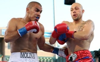 Carlos Molina (left) delivers a bodyshot en route to shattering Kermit Cintron's career. Photo by: SHOWTIME BOXING