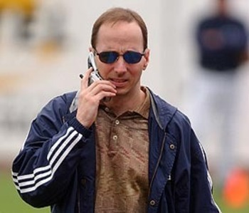 Brian Cashman hard at work...or placing his dinner order.