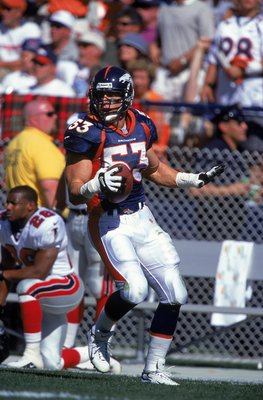 Romanowski's heart, toughness and leadership helped get the Broncos over the top.