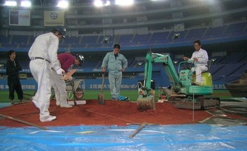 Working on the mound in Osaka. (Photo from groundskeeper.mlblogs.com)