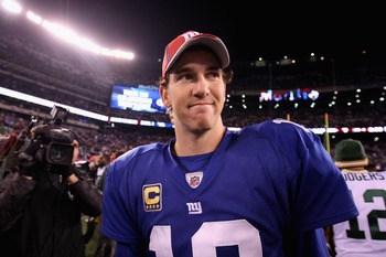 EAST RUTHERFORD, NJ - DECEMBER 04:  Eli Manning #10 of the New York Giants lookx on after the Giants lost to the Green Bay Packers 38-35 at MetLife Stadium on December 4, 2011 in East Rutherford, New Jersey.  (Photo by Al Bello/Getty Images)