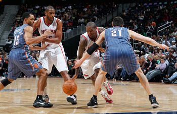 Crawford (with ball) on the Hawks playing the Bobcats last season