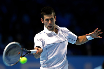 LONDON, ENGLAND - NOVEMBER 25:  Novak Djokovic of Serbia hits a forehand during the men's singles match against Janko Tipsarevic of Serbia during the Barclays ATP World Tour Finals at the O2 Arena on November 25, 2011 in London, England.  (Photo by Clive