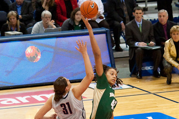 Baylor's Brittney Griner and UConn's Stefanie fight for the tip in last year's matchup