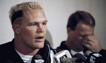 Brian Bosworth speaks to the media; Barry Switzer facepalms.