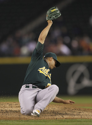 SEATTLE - SEPTEMBER 28:  Starting pitcher Gio Gonzalez #47 of the Oakland Athletics spears a line drive off the bat of Kyle Seager of the Seattle Mariners in the fifth inning at Safeco Field on September 28, 2011 in Seattle, Washington. (Photo by Otto Gre