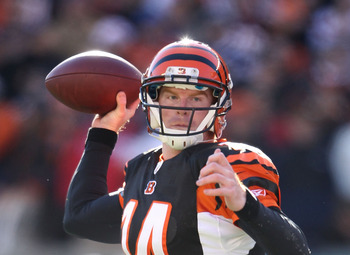CINCINNATI, OH - DECEMBER 11:  Andy Dalton #14 of the Cincinnati Bengals  throws a pass during the NFL game against Houston Texansat Paul Brown Stadium on December 11, 2011 in Cincinnati, Ohio.  (Photo by Andy Lyons/Getty Images)
