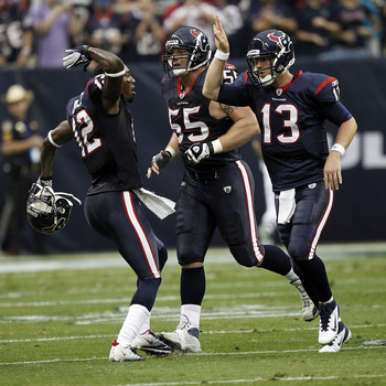 HOUSTON - DECEMBER 04:  Quarterback TJ Yates #13 of the Houston Texans receives high fives from Jacoby Jones #12 and Chris Myers #55 after throwing  a touchdown pass in the second quarter at Reliant Stadium on December 4, 2011 in Houston, Texas.  (Photo b