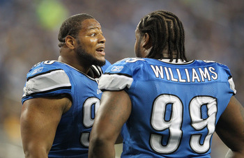 DETROIT, MI - NOVEMBER 24:  Ndamukong Suh #90 of the Detroit Lions talks with teammate Corey Williams #99 during the game against the Green Bay Packers at Ford Field on November 24, 2011 in Detroit, Michigan. The Packers defeated the Lions 27-15. (Photo b