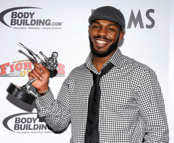 Jones holding his award for 2011 Fighter of the Year.