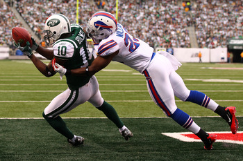 EAST RUTHERFORD, NJ - NOVEMBER 27:   Santonio Holmes #10 of the New York Jets cannot hold onto a touchdown pass as  Aaron Williams #23 of the Buffalo Bills defends during their pre season game on November 27, 2011 at  MetLife Stadium in East Rutherford, N