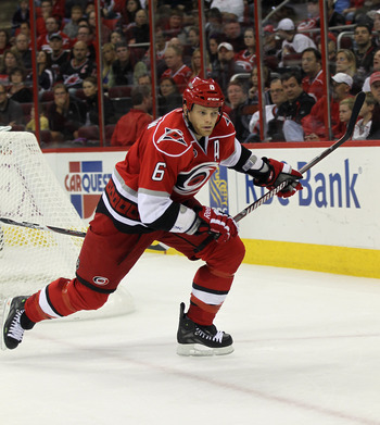 RALEIGH, NC - OCTOBER 07:  Tim Gleason #6 of the Carolina Hurricanes skates against the Tampa Bay Lightning at the RBC Center on October 7, 2011 in Raleigh, North Carolina. The Lightning defeated the Hurricanes 5-1.  (Photo by Bruce Bennett/Getty Images)