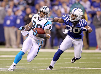 INDIANAPOLIS, IN - NOVEMBER 27:  Steve Smith #89 of the Carolina Panthers runs with the ball while defended by David Caldwell #30 of the Indianapolis Colts during the game at Lucas Oil Stadium on November 27, 2011 in Indianapolis, Indiana.  (Photo by Andy