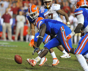 GAINESVILLE, FL - NOVEMBER 26:  Defensive tackle Jaye Howard #6 of the Florida Gators recovers a fumble against the Florida State Seminoles November 26, 2011 at Ben Hill Griffin Stadium in Gainesville, Florida.  (Photo by Al Messerschmidt/Getty Images)