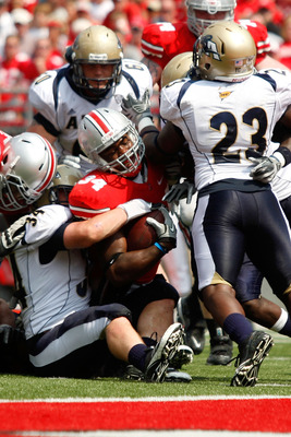 COLUMBUS, OH - SEPTEMBER 3:  Brian Wagner #34 of the Akron Zips wraps up Nate Ebner #34 of the Ohio State Buckeyes during the third quarter on September 3, 2011 at Ohio Stadium in Columbus, Ohio. Ohio State defeated Akron 42-0. (Photo by Kirk Irwin/Getty