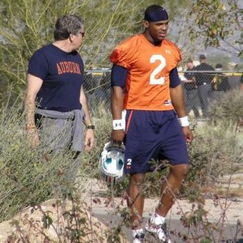 The elusive Tim Jackson with Cam Newton in Arizona in January of 2011. Photo courtesy of al.com