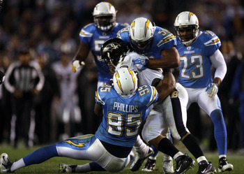 SAN DIEGO, CA - DECEMBER 18:  Ray Rice #27 of the Baltimore Ravens is tackled by Shaun Phillips #95 and Na' il Diggs #58 of the San Diego Chargers during their NFL Game on December 18, 2011 at Qualcomm Stadium in San Diego, California. (Photo by Donald Mi