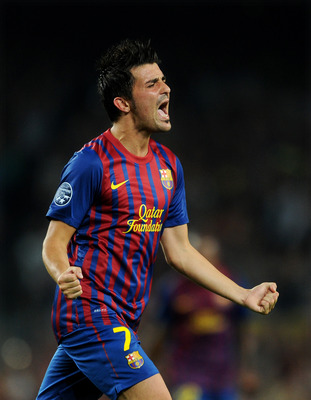 BARCELONA, SPAIN - SEPTEMBER 13:  David Villa of FC Barcelona celebrates scoring his sides second goal during the UEFA Champions League group H match between FC Barcelona and AC Milan at the Camp Nou stadium on September 13, 2011 in Barcelona, Spain.  (Ph