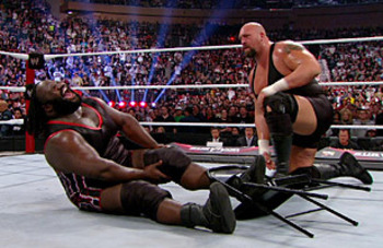 Mark Henry gets destroyed by Big Show with a steel chair.