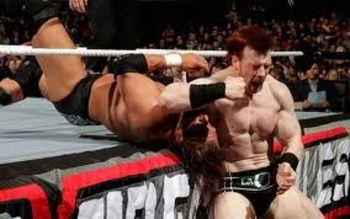 Sheamus brutalizes Triple H at 2010's Extreme Rules event.