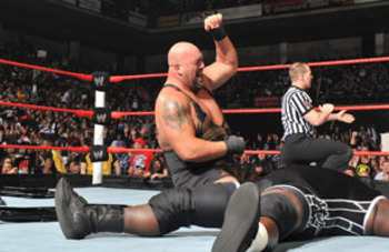Big Show defeats Mark Henry to win his first-ever World Heavyweight Championship.