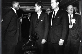 Heisman winner Ernie Davis (left) met President Kennedy (center).