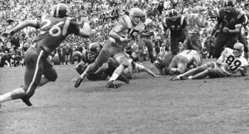 Roger McFarland (No. 15) scored two TDs for the Jayhawks.