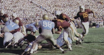 Minnesota QB Sandy Stephens (No. 15) led the Gophers to victory.