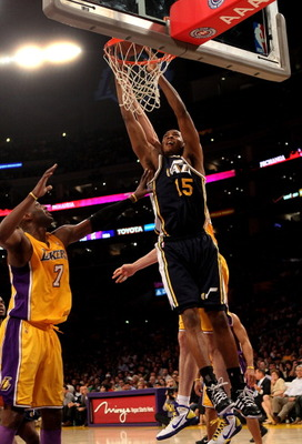 LOS ANGELES, CA - APRIL 05:  Derrick Favors #15 of the Utah Jazz DUNKS over Lamar Odoml #7 of the Los Angeles Lakers at Staples Center on April 5, 2011 in Los Angeles, California. The Jazz won 86-85.  NOTE TO USER: User expressly acknowledges and agrees t
